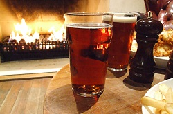 pub-dinner-by-warm-fire-soft-light-1324917 (1).jpg